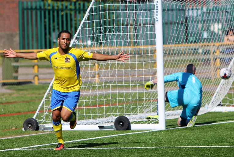 Tyrrell Webbe celebrates his goal for Barry Town against Undy Athletic.
