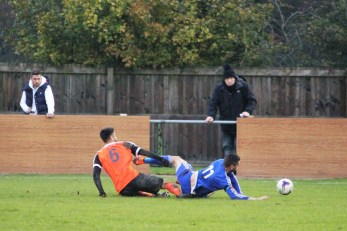 Action as Newton Aycliffe (blue) take on Worksop Town in the FA Vase.
