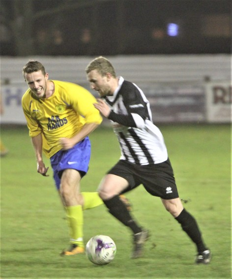 Action as Northallerton (black and white) take on Ryton & Crawcrook in the Ernest Armstrong Cup.