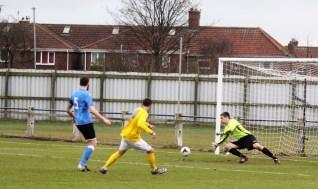 Billingham Town goalie Thomas Dawson saves from Cleethorpes Town forward Brody Robertson.