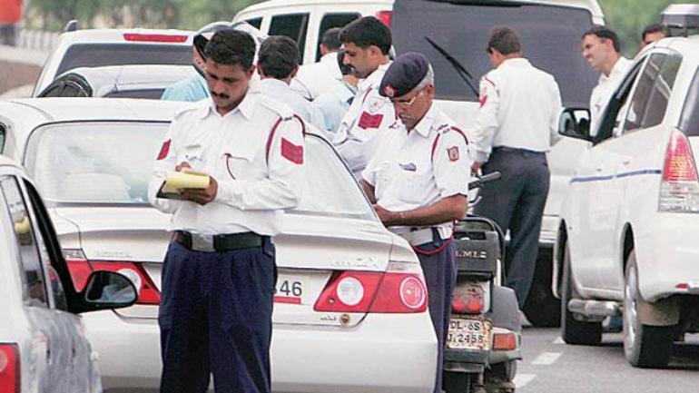 New motor vehicle act, gurugram police, scooty, traffic police,