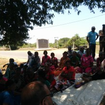 Silavathurai Police OIC and Intelligence personnel watch on throughout our 2+ hour meeting with the villagers