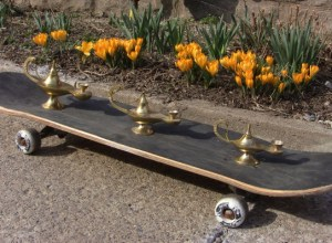 The three genie lamps on a skate board.