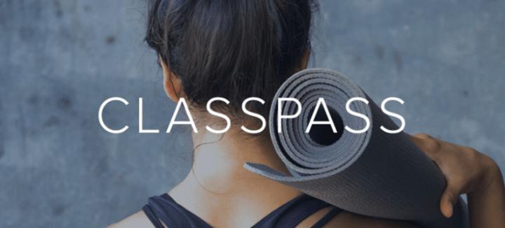 Woman holding yoga mat