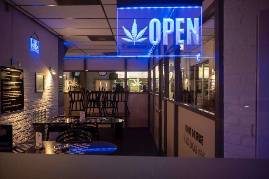 essential-cannabis-business-with-open-sign