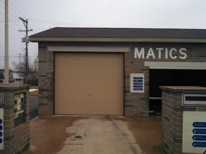 tan commercial garage door at a car wash