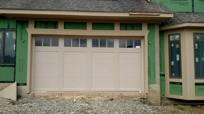 tan garage door with windows