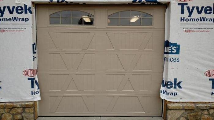 sandtone garage door with windows