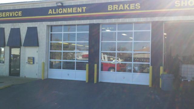 Meineke full view glass garage doors