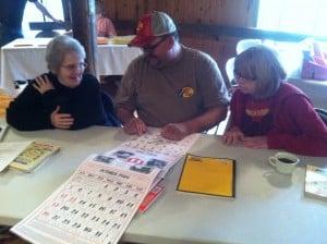 Grow Appalachia participants study Bernie's Almanac Calendar