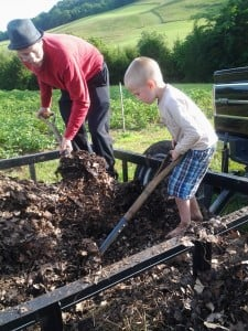our youngest helper and his Dad monday nite loading leaf mulch