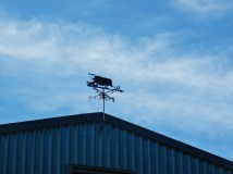 Tractor weather vane at a farm