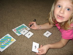 Marking and reading her words (without pictures, so she can't guess)