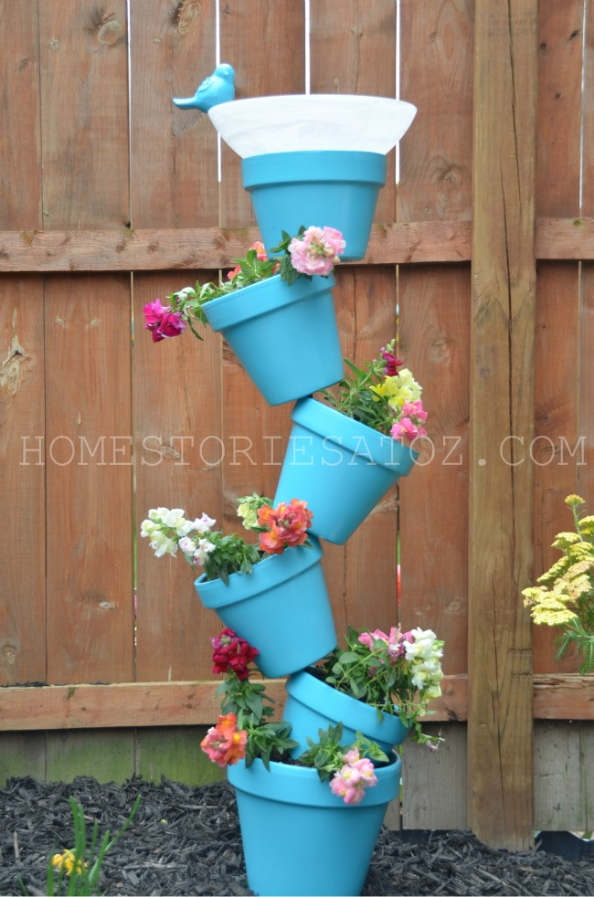 Topsy turvy terracotta vertical garden with bird bath. Photo: Home Stories A to Z.