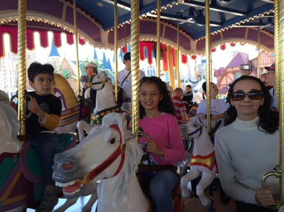 riding the carrousel at Disney