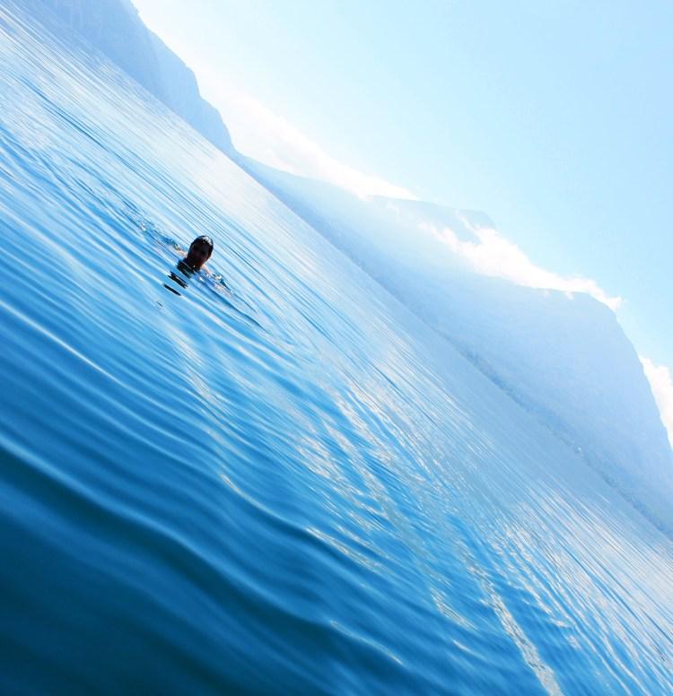 Swimming in the clear waters of lake Atitlan. Guatemala