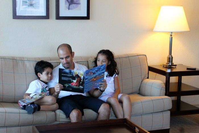Hispanic family reading together