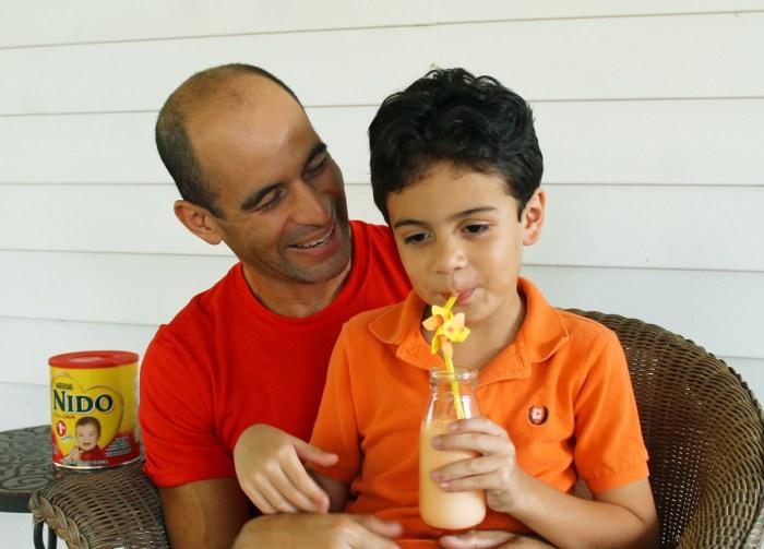 boy with father drinking pumpkin pie milkshake