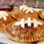 These Football chocolate strawberry empanadas with snickers are perfect for the big game party!