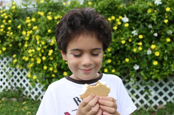 boy eating s'mores