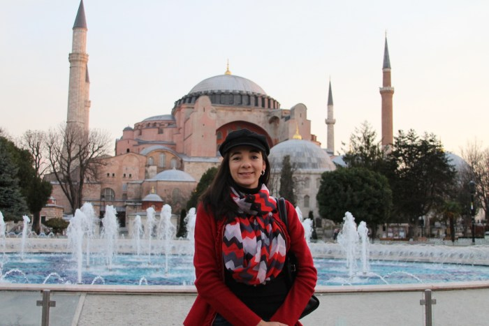 Woman standing in from of Hagia Sophia in Istanbul
