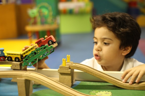 kid playing with trains