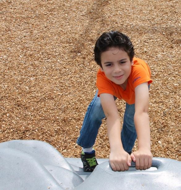 teaching leadership skills boy climbing
