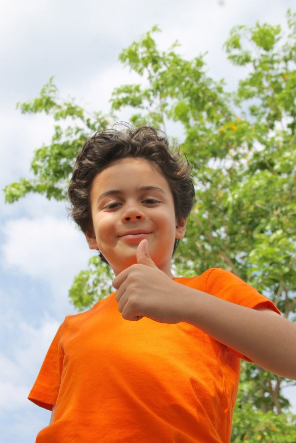 teaching leadership skills boy with a thumbs up