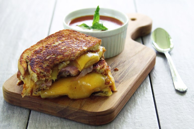 This take on the traditional grilled ham and cheese sandwich adds some tropical flavor with grilled pineapple and teriyaki mayo.