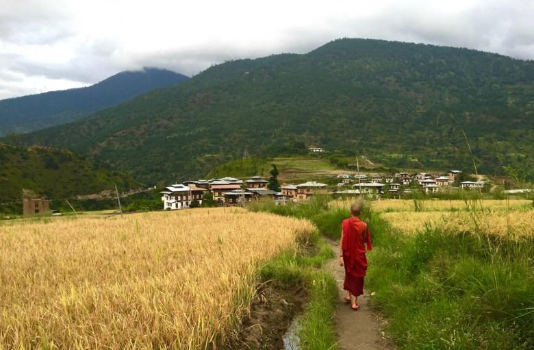 monk walking in Bhutan