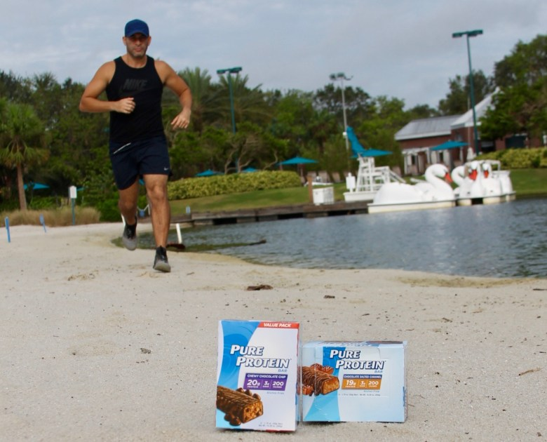 Pure Protein running on the beach
