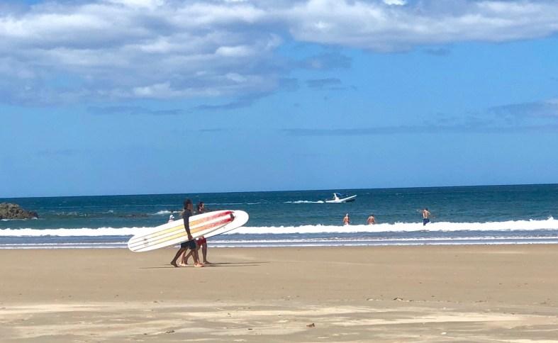 surfers in Tamarindo Beach Costa Rica