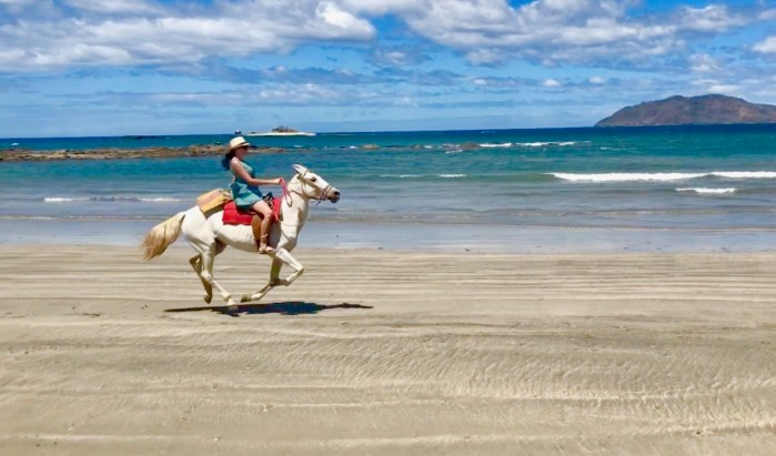 Horseback riding on the beach in Costa Rica