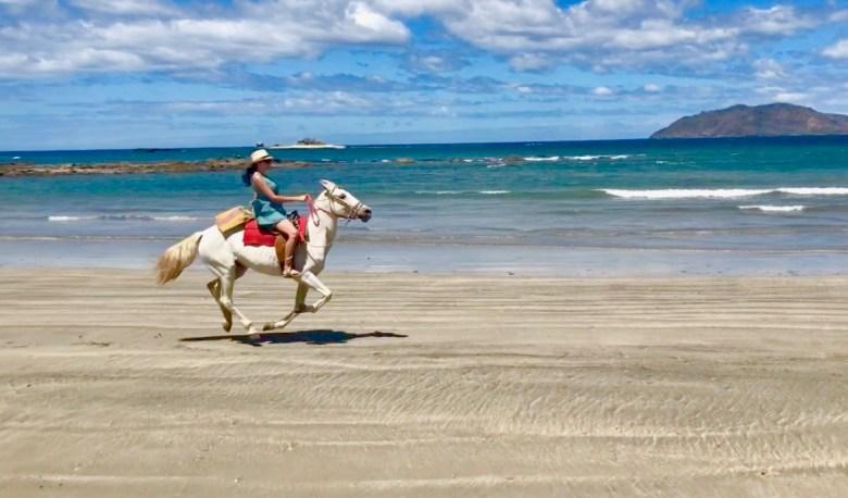 Horseback riding on the beach in Costa Rica