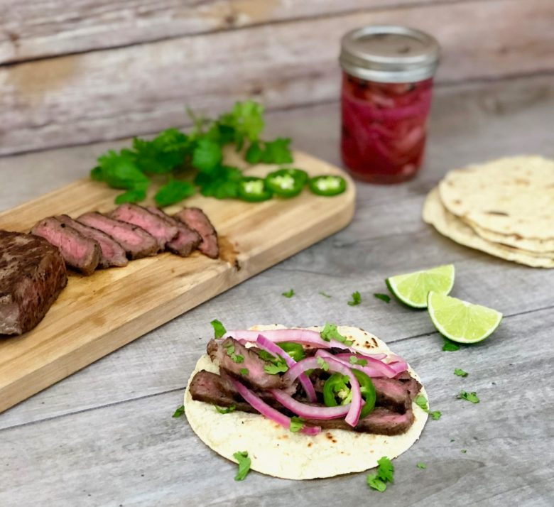 grilled skirt steak tacos with pickled onions