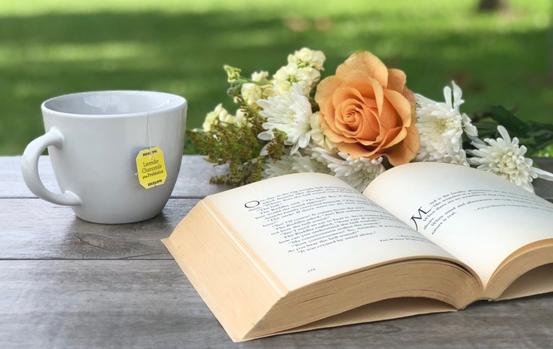 book with cup of bigelow tea