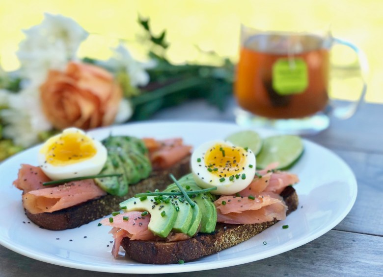 Avocado toast with salmon and soft boiled egg