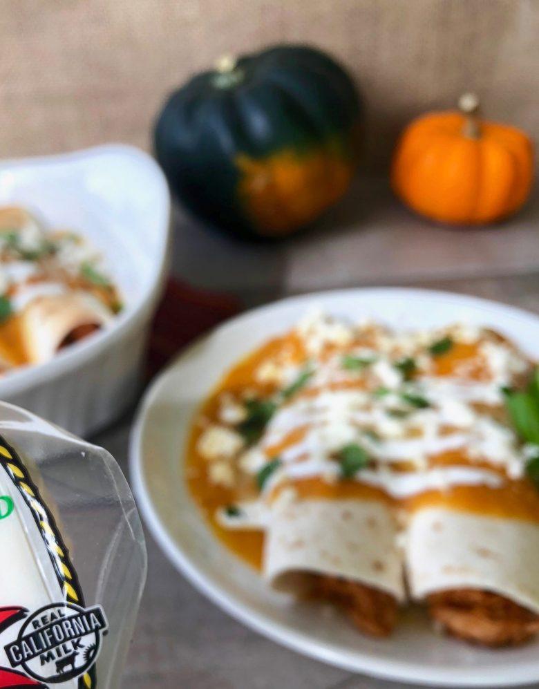 The best holiday enchiladas: Cheesy Chipotle Chicken Enchiladas with Pumpkin Squash Sauce