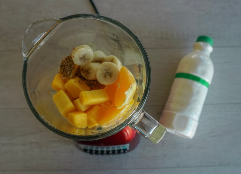 high protein orange and mango smoothie bowl