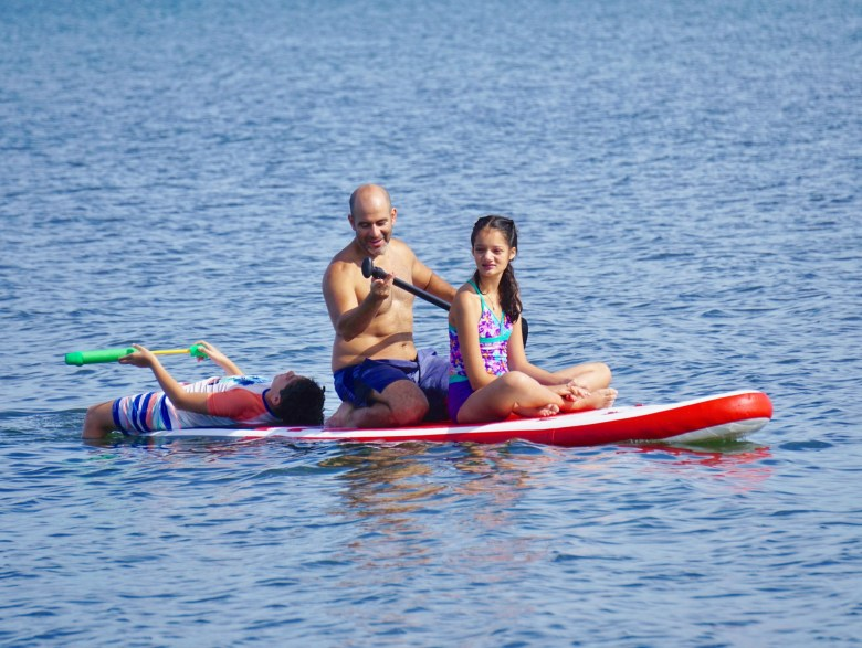 family paddle boarding