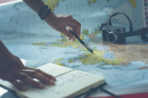 making travel plans on a world map
