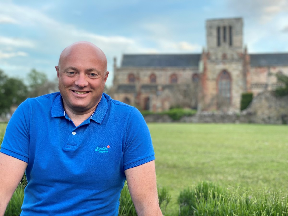 Portrait of Graham Wells on reaching self-employment as a financial coach