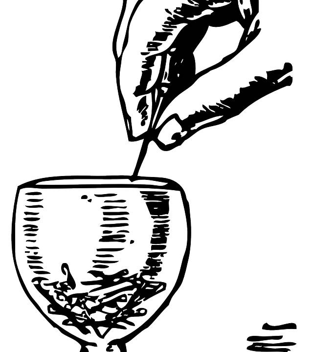 A hand discreetly dropping a substance into a goblet