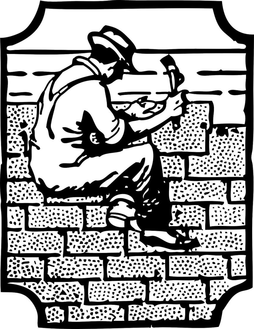 Man on a wall laying bricks