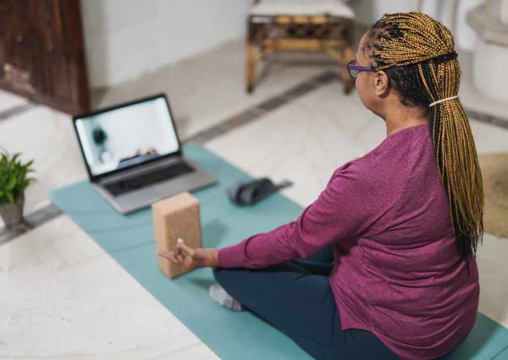 older woman taking yoga class   8 Tips to Easily Hosting Online Events for Your B2C Business