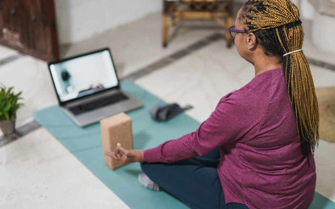older woman taking yoga class | 8 Tips to Easily Hosting Online Events for Your B2C Business