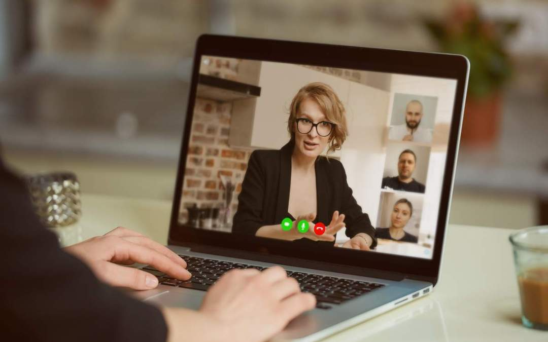 woman in blazer hosting virtual event on laptop | Virtual Events Guide: Ultimate Playbook for Small Biz Owners