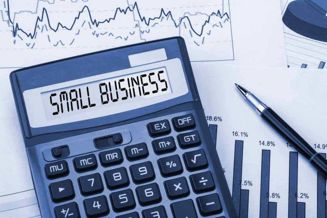 small business on calculator with graphs showing chapter 11 bankruptcy