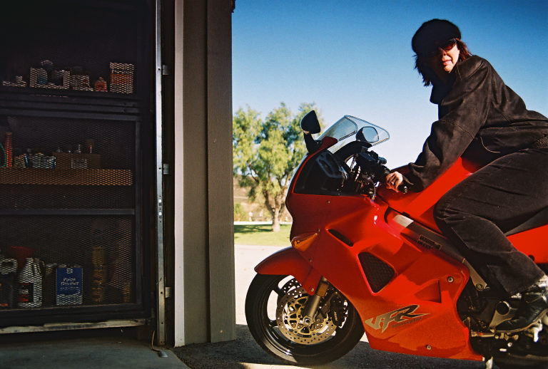 on motorcycle for 'you'll see it soon' drug commercial