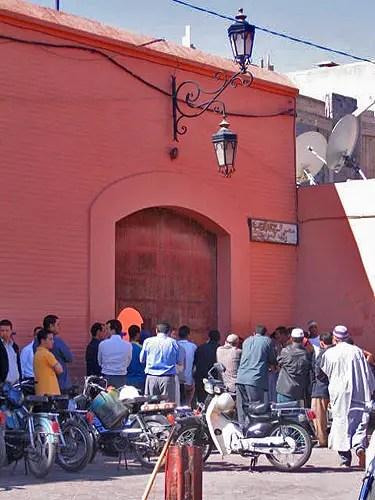 Men gather outside mosque